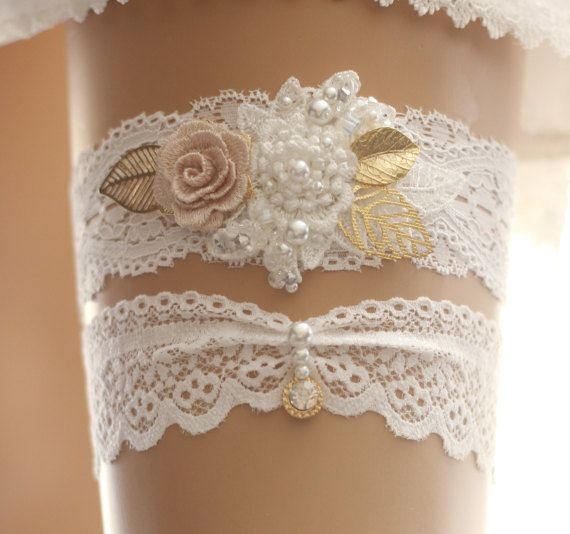 """*Gorgeous handmade flower motif lace garter set It's perfect for your special day!  *Size Please measure around thigh with a soft measuring tape and select your thigh measurement from drop down menu. Wedding garters are generally worn roughly 2-5"""" above the knee to around mid-thigh. *Color& Materials -Off white elastic lace -hand beaded flower motif& gold leaf -Pearl, Rhinestone pieces -gold rhinestone charm -Crystal beads, pearls  **each of my creations is made of high quality materi..."""