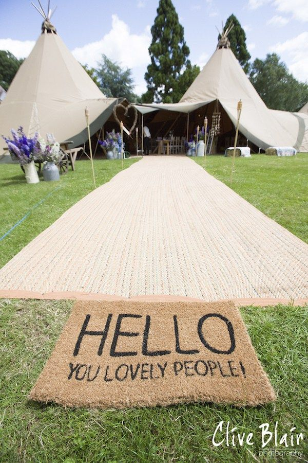 Hello You Lovley People Tipi Entrance - Sami Tipi Wedding captured by Clive Blair