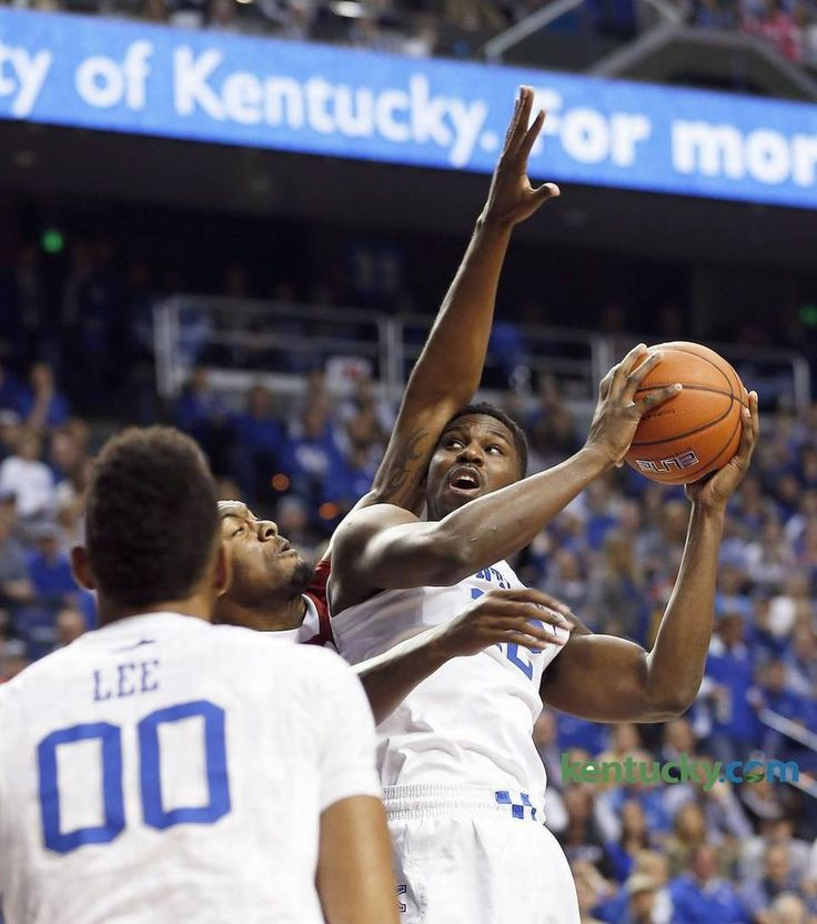 Alabama Crimson Tide forward Jimmie Taylor (10) fouled Kentucky Wildcats forward Alex Poythress (22)as the University of Kentucky played the University of Alabama in Rupp Arena in Lexington, Ky., Tuesday, February 23 2016. This is first half mens basketball action.