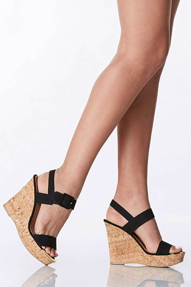 4afe9be96 Platform style cork wedges with a sleek design. You won t want to take  these babies off!
