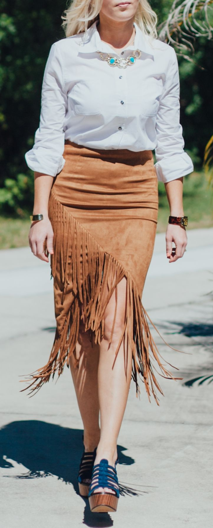 A fabulous suede skirt is a must-have for spring, and why not add a little fringe?! We love this skirt paired with crisp tops and boho accessories! Try a wooden-heeled shoe and turquoise accents! Would you wear this look?