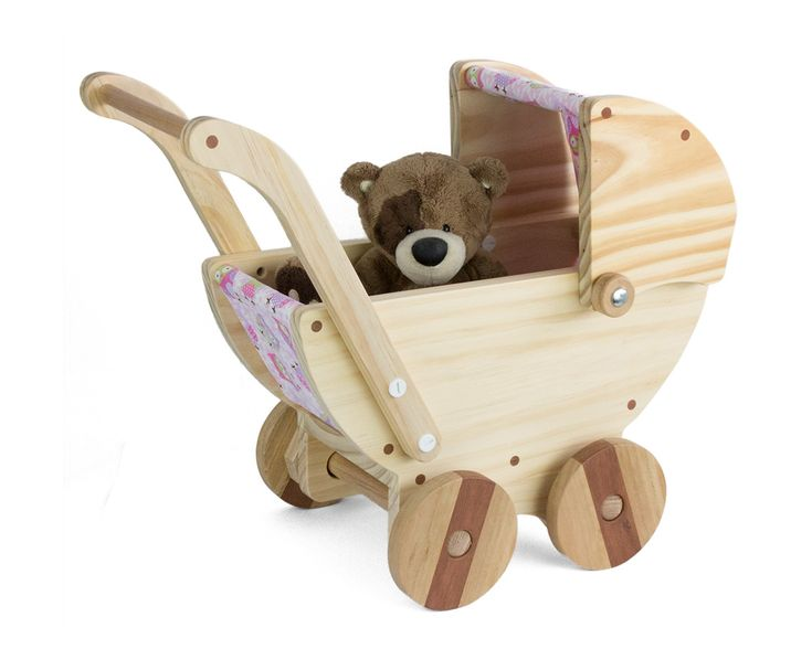 These wooden toy prams are made from pine timber, the hood is movable and the fabric cover can easily be unclipped for washing if needed.