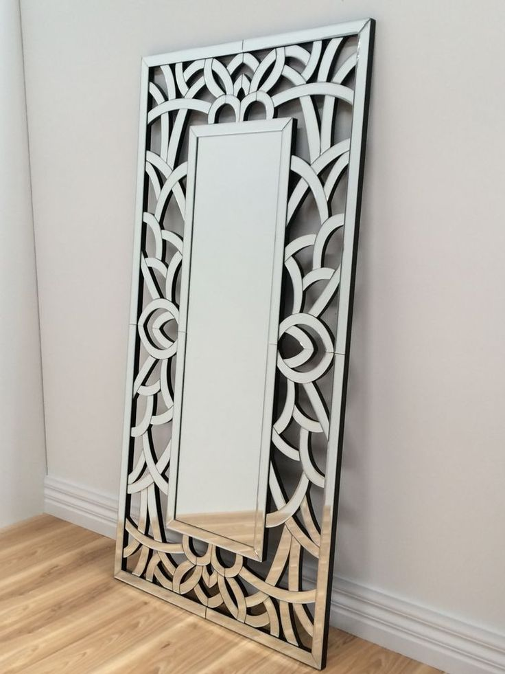 Love this wall or floor mirror for entrance.