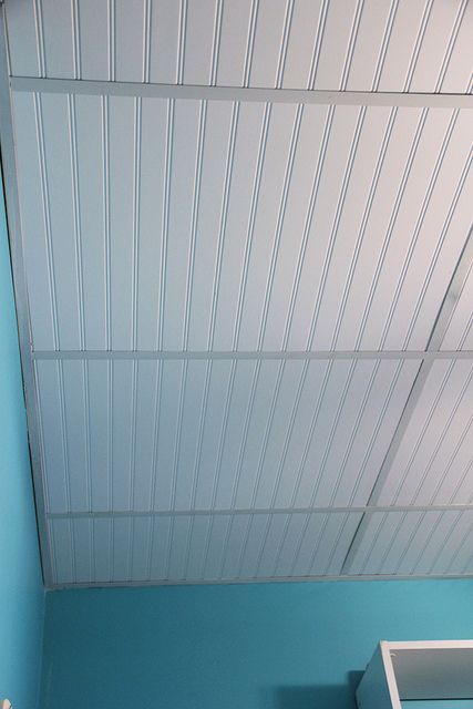 dress up a drop ceiling by replacing fiberglass tiles with beadboard
