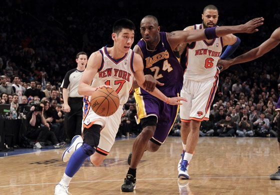 Knicks guard Jeremy Lin drives by Lakers superstar Kobe Bryant