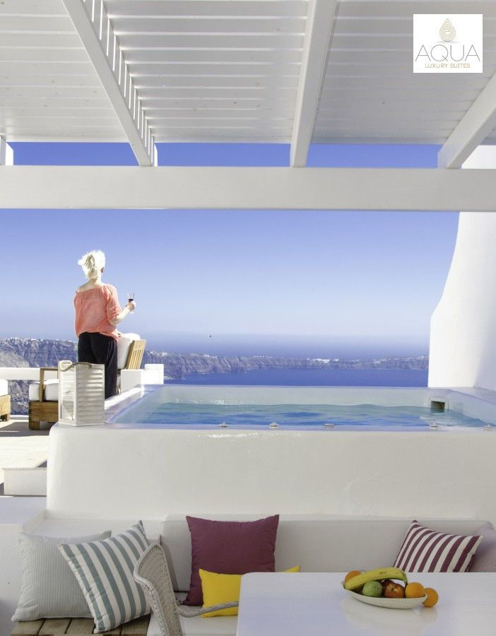 Just the place to be…a glass of wine, a private Jacuzzi and this view! More at aquasuites.gr
