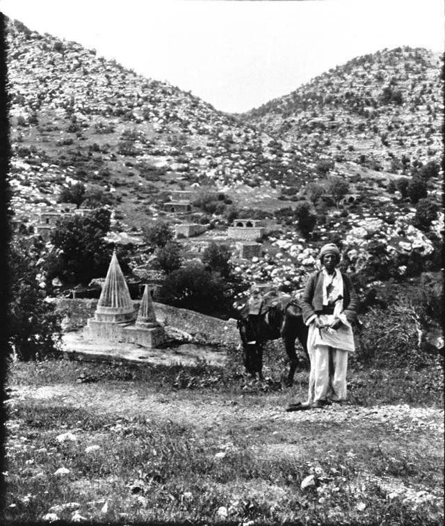 Sheikh Adi, View of village and shrine with two fluted spires of Sheikh Adi, founder of the Yezidi faith, May 1909, Gertrude Bell Archive, Newcastle University