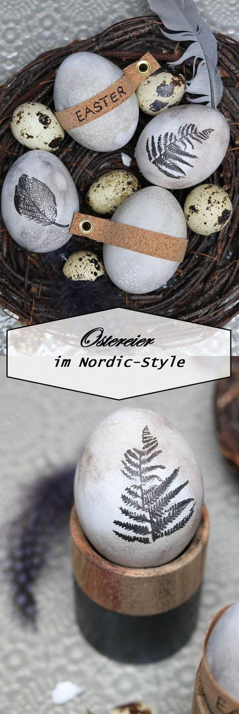 graue Ostereier mit Naturmotiven und Korkband