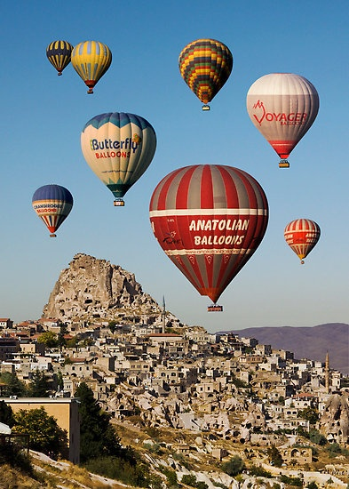 Hot air balloons float over the surreal landscape of Cappadocia, Turkey