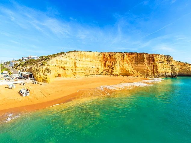 Praia De Benagil Is A Small Beach That Sits Nestled Between Cliffs At The Bottom Of Deep Valley In Algarve Portugal