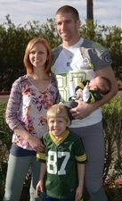 Green Bay Packers receiver Jordy Nelson (87) poses with wife Emily Nelson (left) and son Royal Nelson during team photos for the 2015 Pro Bowl at The Arizona Biltmore. Description from usatodaysportsimages.com. I searched for this on bing.com/images