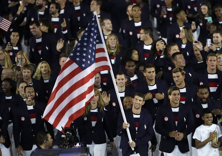 Michael Phelps carries the flag of the United States during the 2016 Summer Olympics Opening Ceremony.