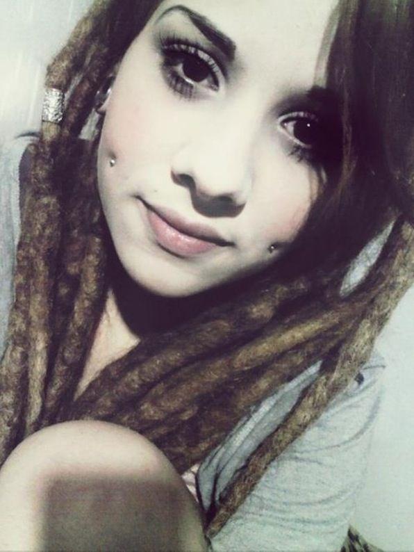 cheek piercings and dreads