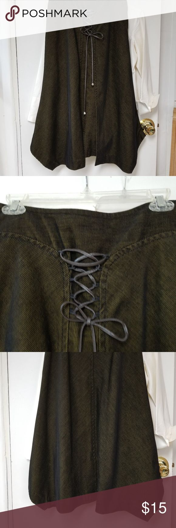 """HAZEL Corduroy Long Skirt Two-tone Black Sm Pre-owned, excellent condition. Asymmetrical hem thin wale corduroy skirt with brown leatherette lace-up front. The two-tone black wale with dark olive green background tricks the eye, to make the color appear brown. This makes it easy to combine with different colors. Side zipper closure; 55% Cotton 45% Poly; fully lined 100% Poly. Label says Dry clean but I have washed it in cold water and it has maintained its sizing. Waist 28""""; side length 28""""…"""