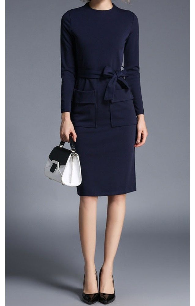 Navy mid length long sleeve pencil dress with matching ribbon bow and front pckets