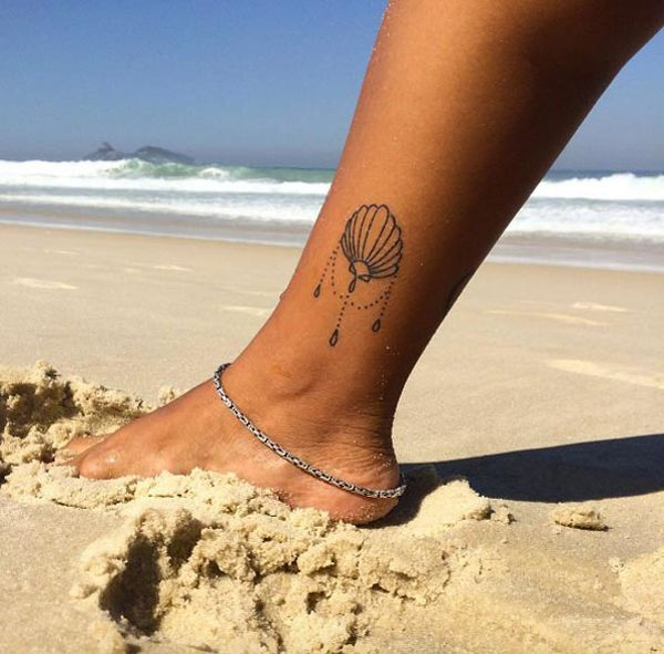 50 beautiful seashell tattoos designs you ll love for Seashell tattoo meaning