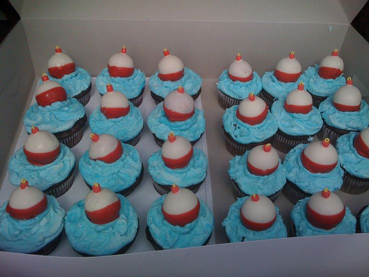 """Cupcakes with Cake Ball Bobbers - My grandson really wanted a fishing theme for his 7th birthday classroom celebration. I made triple chocolate cupcakes with buttercream """"water"""". Bobbers are strawberry cake balls dipped in white chocolate (double dipped to cover the pink of the strawberry), then the bottom half dipped in red chocolate. The tops of the bobbers are gumpaste."""