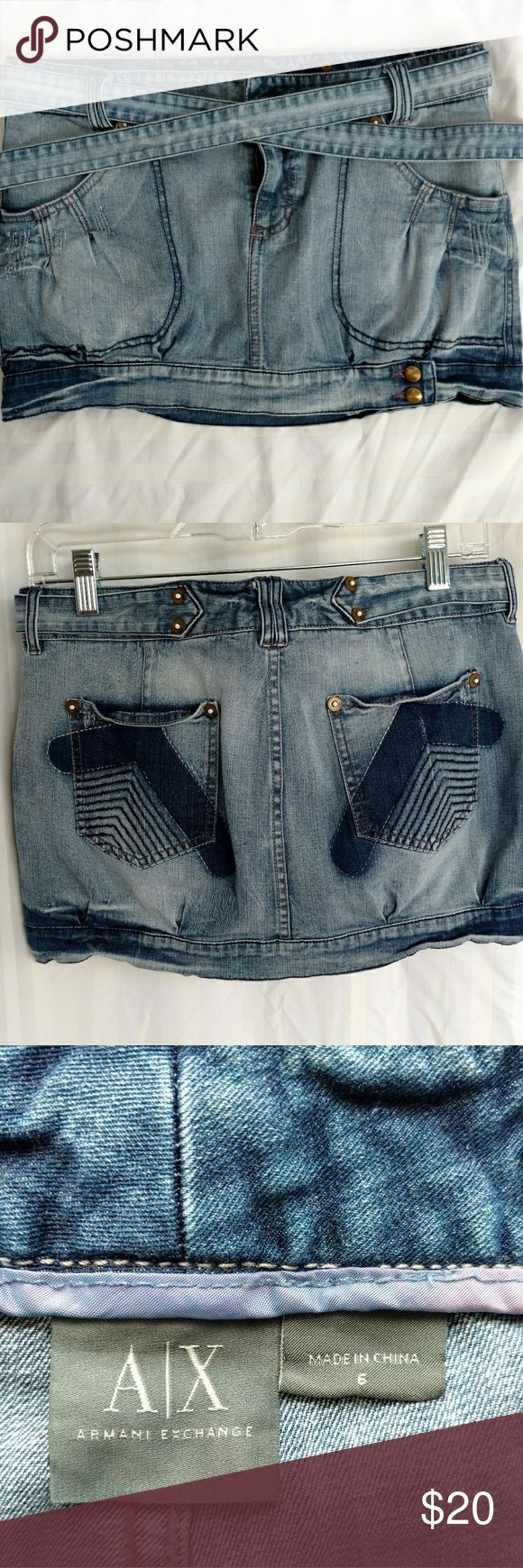 """A/X denim mini skirt Armani Exchange denim mini-skirt. Cute button embellishments at the hem. Measures approximately 16"""" at the waist and 13"""" long.  All offers will be considered. Thanks for looking! Armani Exchange Skirts Mini"""