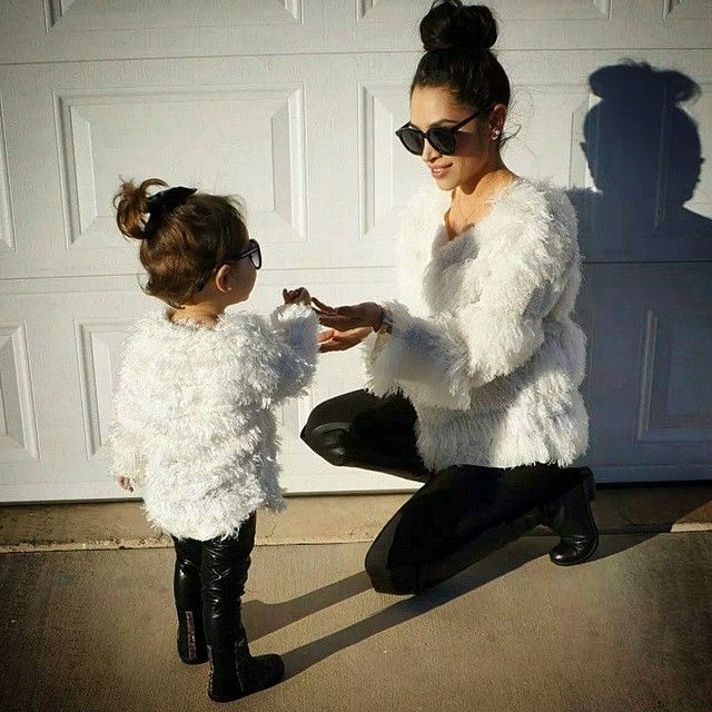 Cute mother & daughter matching outfits - high bun, jumper, leather trousers, sunglasses