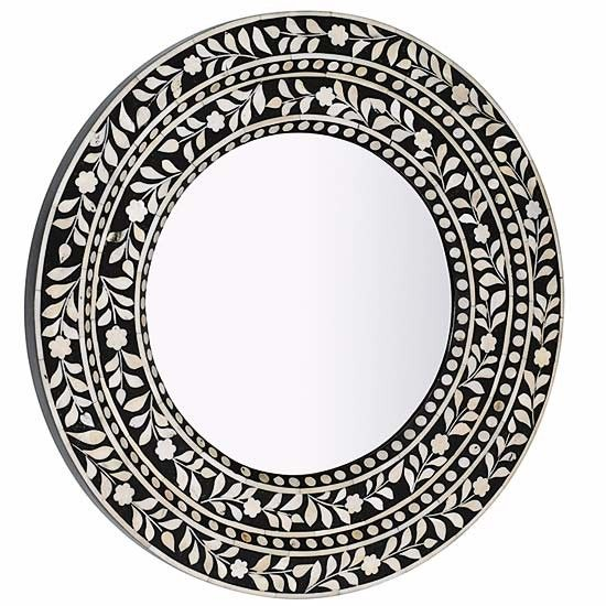 Lombok mirror | An intricate design formed with inlaid bone.    Round in wood with bone inlay (Dia60cm), £125, Lombok.