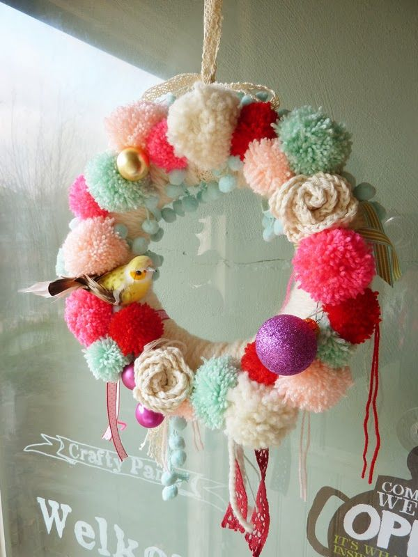 Pom pom wreath, love the hanging ribbons and the pretty birdie