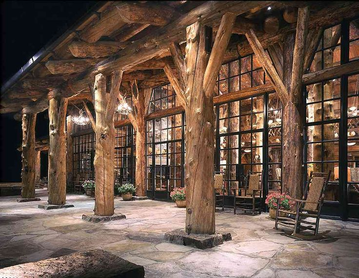 AMAZING!!! Solid glass and log home. Amazing porch with the huge tree trunks serving as structural support. Montana/Idaho Log Home Company, Victor, Montana.