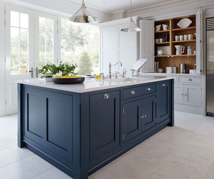 dark blue kitchen with cream tiles