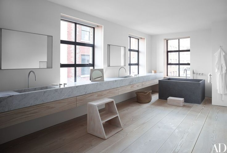 Pawson designed the master bath's soaking tub and fittings; the counter is a 20-foot-long slab of Carrara marble   archdigest.com