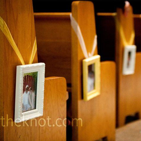 Modern aisle decor. Pictures of the bride and groom throughout the years hung from the pews/chairs.