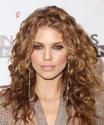 Best cut for fine-to-medium hair w/ tight spiral curls: long cut, the curlier, the longer the layers, hair tamed w/ defined curls & tapered at ends w/ layers- apply smoothing serum, gently scrunch damp strands, blow-dry hair w/ diffuser, using fingers to pull hair gently to preserve natural texture as much as possible, lightly apply curl cream to dry hair to define pieces in the front, use 1' curling iron on key pieces around your face, hairspray