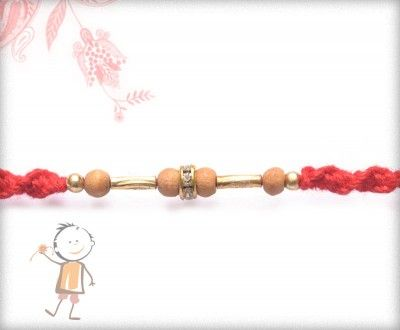 Buy Online Rakhi - #Designer #Sandalwood #Diamond #Rakhi, Delicate Sandwood Diamond Rakhi with Handcrafted Red Thread, surprise your loved ones with roli chawal, chocolates and a greeting card as it is also a part of our package and that too without any extra charges. http://www.bablarakhi.com/