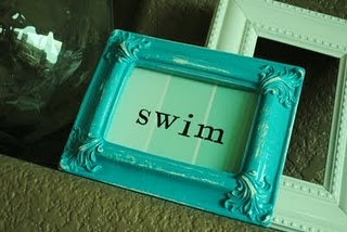 Paint sample stamped with swim in a painted thrift store frame.