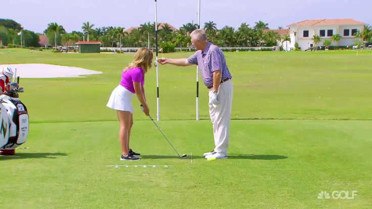 Martin Hall and Sara Brown show off a drill that Rickie Fowler uses to help get the ball on line.