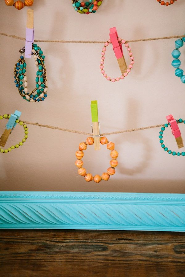 """Cute way to see all the beaded bracelets in a consignment or resale shop! TGtbT.com says """"Note that the clothes pins are dipped in season-appropriate colors"""" Click for lots of jewelry display ideas on our resale shopkeeper blog"""
