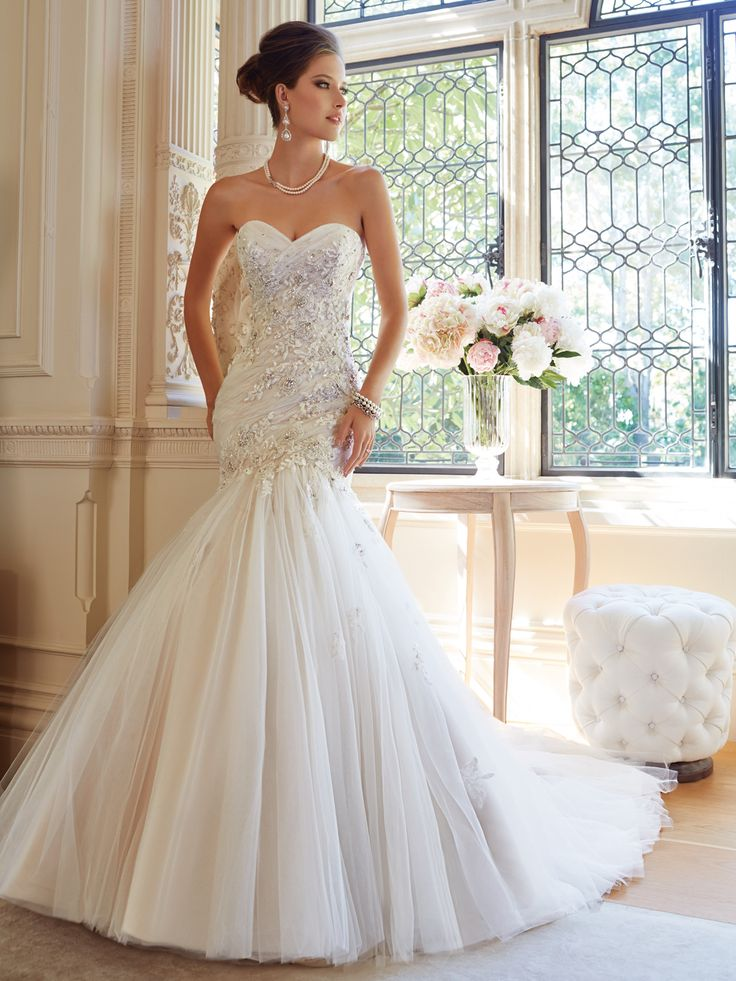 Available at Enchantment Bridal and Formal Gowns, 10 King Street West, Chatham Ontario Tilda by Sophia Tolli  Wedding Dresses 2014 Collection – Luxurious textures combine to create an extraordinary look in Tilda, a strapless trumpet gown in misty tulle decorated with crystal hand-beaded lace appliqués. Delicately draped tulle adorns the sweetheart neckline and body-conscious bodice with dropped waistline. Gorgeous lace appliqués spill onto the skirt and down the chapel length train. A [...]