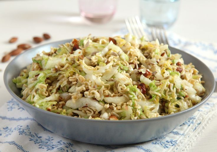 This is my favorite noodle salad: instant ramen noodles, napa cabbage and lots of roasted almonds and sunflower seeds.    This salad's original name is actually Yum Yum Salad, named after the instant ramen noodles brand used to make it.