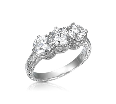Three Large Round Diamonds In An Expertly Hand Engraved Antique Style Ring The Classic Stone Wedding Anniversary Is Elegantly Upgraded With