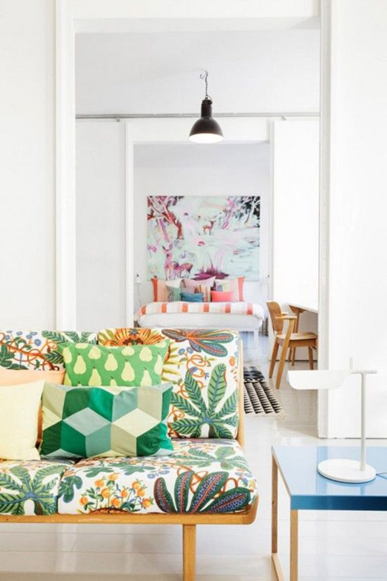 I love brights and pattern layered over white. Love this lounge and the bathroom is fab too. via Paper and Stitch