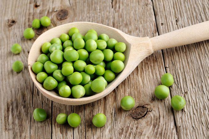 Fresh peas in spoon by windu on Creative Market