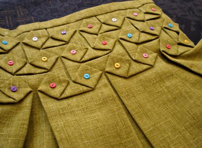 Origami smocking.  Have to figure out how to do this...