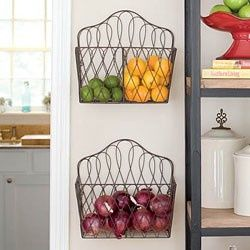 Using magazine racks to hold produce in kitchen. One of my favorite Pinterest kitchen ideas! - On the sides of the sink?