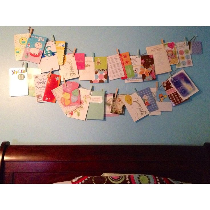 Get crafty with some old cards, clothes pins and string for decoration over your bed.