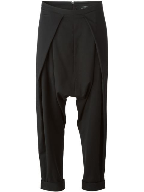 Shop Nomad pleated drop crotch trousers in Pollyanna from the world's best independent boutiques at farfetch.com. Over 1000 designers from 300 boutiques in one website.