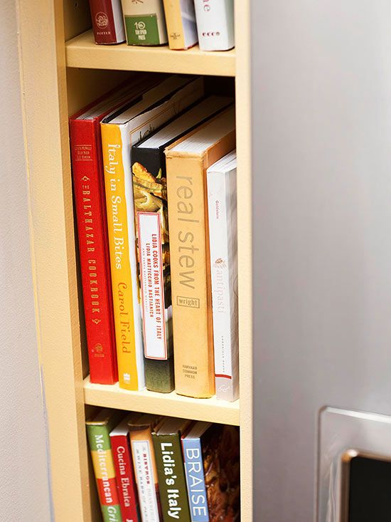 Cookbook Central  Carve out a niche for cookbooks in a sliver of space next to a refrigerator. Organize cookbooks by category on each shelf.
