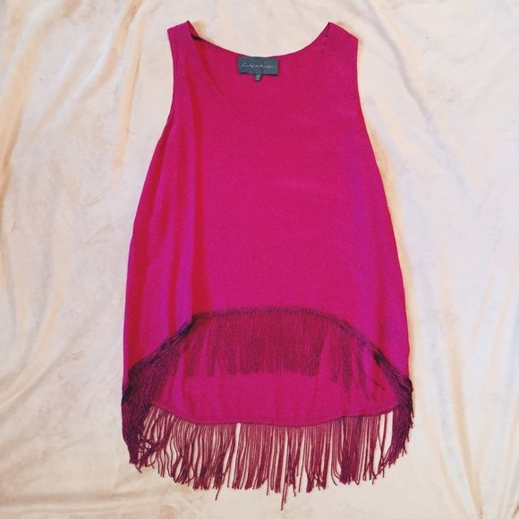 Fun magenta fringed blouse Cute magenta top with fringe at bottom for a fun night out (size is xs but can definitely be suitable for up to a medium) Tops Blouses