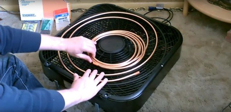 Laying down coil onto box fan for DIY AC