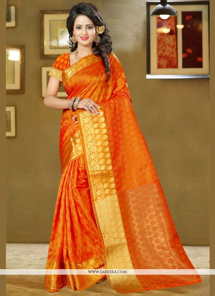 Ravishing attire to enhance your beauty. Make an adorable statement in this smashy orange art silk classic designer saree. The weaving work looks chic and perfect for any occasion. Comes with matching...