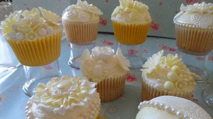 lemon and vanilla flavoured cupcakes decorated with pale yellow and white decorations