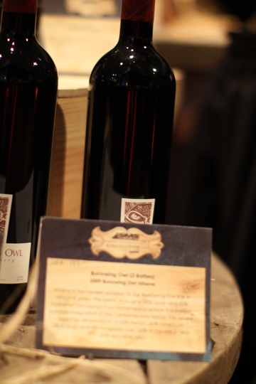 Custom lot description signs with tasting notes for guests were done in a matte finish to further the vintage theme.