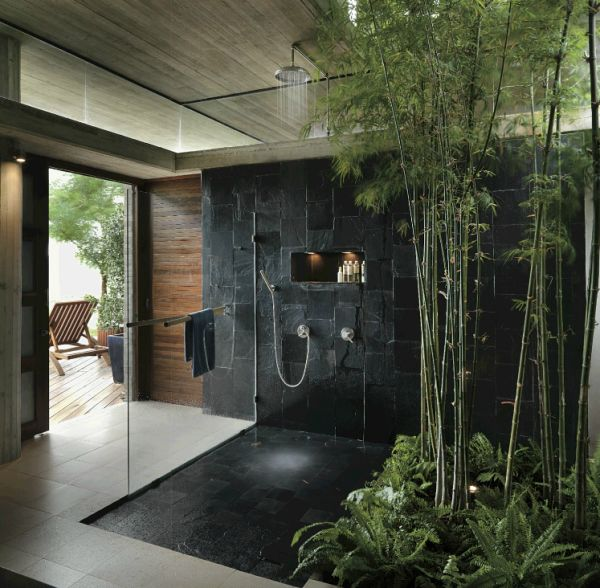 Inspiration from Bathrooms.com: Lush bamboo and ferns in slate shower create a truly tropical set!